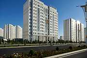 Ashgabat, Turkmenistan - 2017 September 21: A view of marble white apartment blocks in a street while 2017 Ashgabat 5th Asian Indoor &amp; Martial Arts Games on September 21, 2017 in Ashgabat, Turkmenistan.<br /> <br /> Mandatory credit:<br /> Photo by &copy; Adam Nurkiewicz<br /> <br /> Adam Nurkiewicz declares that he has no rights to the image of people at the photographs of his authorship.<br /> <br /> Picture also available in RAW (NEF) or TIFF format on special request.<br /> <br /> Any editorial, commercial or promotional use requires written permission from the author of image.