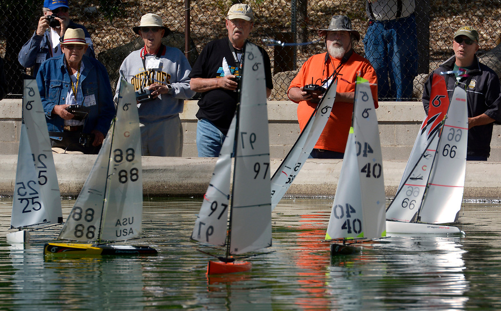gbs042317c/ASEC --Frank Shults of Grand Junction, Colorado, Denny Hanson of Boulder, Colorado, Ernie Thorpe of Ventura, California, Gilford Hawn of Los Lunas and Mark Sutton of Albuquerque, from left, vie for position on the starting line during the radio controlled Tenth Annual Rio Grande Cup Regatta at Tingely Beach on Sunday, April 23, 2017. (Greg Sorber/Albuquerque Jounal)