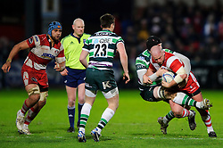 Gloucester replacement (#17) Nick Wood is tackled by London Irish replacement (#19) Matt Garvey during the second half of the match - Photo mandatory by-line: Rogan Thomson/JMP - Tel: Mobile: 07966 386802 15/12/2012 - SPORT - RUGBY - Kingsholm Stadium - Gloucester. Gloucester Rugby v London Irish - Amlin Challenge Cup Round 4.