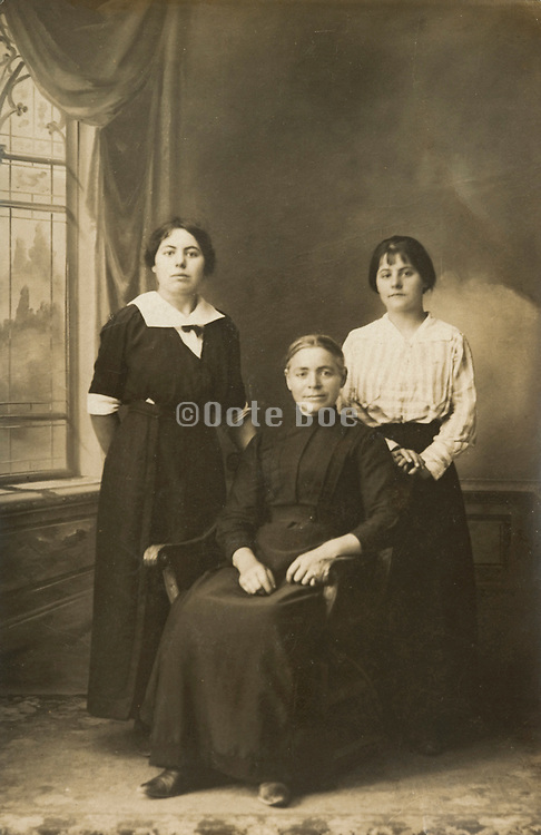 formal portrait of 3 generations daughter mother and grandmother