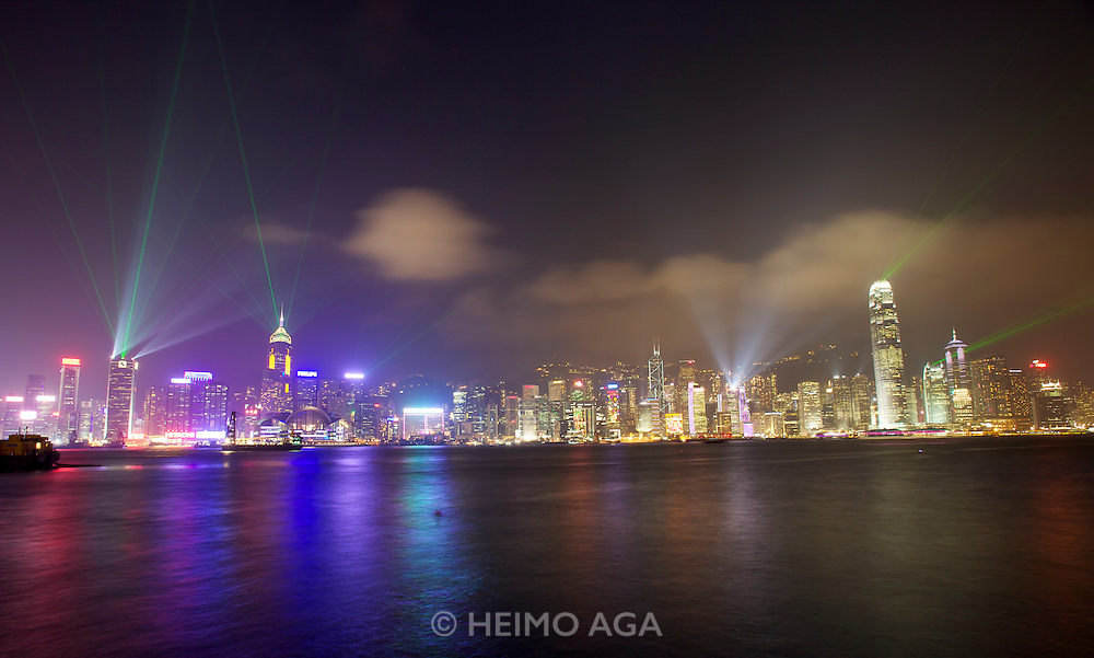 """Hong Kong. The skyline at night, seen from Kowloon side during the daily """"A Symphony of Lights"""" show."""