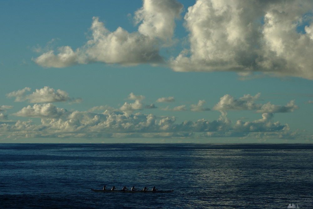 Rapa Nui people in a traditional canoe off the coast of Easter Island, Chile