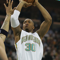 New Orleans Hornets forward David West #30 shoots against the Utah Jazz in the second quarter of their NBA game on April 8, 2008 at the New Orleans Arena in New Orleans, Louisiana.