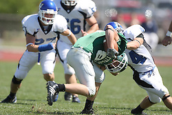 15 September 2007:  Bryan Kelly puts his head down to charge ahead, but Joel Steinmetz meets him with a teeth rattling block. The Titans stood toe to toe with the 25th ranked Lions through the first half but ended the game on the losing end of a 25-15 score at Wilder Field on the campus of Illinois Wesleyan University in Bloomington Illinois.