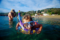ca. May 2002, Martinique --- A four-year-old girl snorkels on Martinique beside her mother. --- Image by © Owen Franken/CORBIS