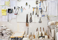 Assorted workshop tools on a pegboard