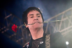 © Licensed to London News Pictures . 09/06/2013 . Heaton Park , Manchester , UK . Johnny Marr performs on the Now Wave stage with a single red carnation clutched between his teeth  . Day 2 of the Parklife music festival in Manchester on Sunday 9th June 2013 . Photo credit : Joel Goodman/LNP