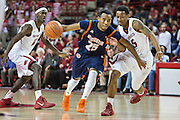 FAYETTEVILLE, AR - DECEMBER 19:  Marshun Newell #25 of the UT Martin Skyhawks drives past Anthlon Bell #5 of the Arkansas Razorbacks at Bud Walton Arena on December 19, 2013 in Fayetteville, Arkansas.  The Razorbacks defeated the Skyhawks 102-56.  (Photo by Wesley Hitt/Getty Images) *** Local Caption *** Marshun Newell; Anthlon Bell
