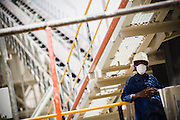 A mine worker rests against the railing of the crushing mill at the Youga gold mine near the town of Youga, approximately 205 km southeast of Burkina Faso's capital Ouagadougou on Tuesday April 28, 2009.