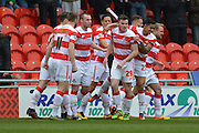 Doncaster Rovers celebrate James Coppinger (26) of Doncaster Rovers  scoring to go 1-0 up   during the Sky Bet League 1 match between Doncaster Rovers and Peterborough United at the Keepmoat Stadium, Doncaster, England on 19 March 2016. Photo by Ian Lyall.