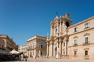 The Baroque facade of the Duomo (Cathedral of Santa Maria delle Colonne) in Duomo Square in Ortigia, Syracuse, Sicily, Italy