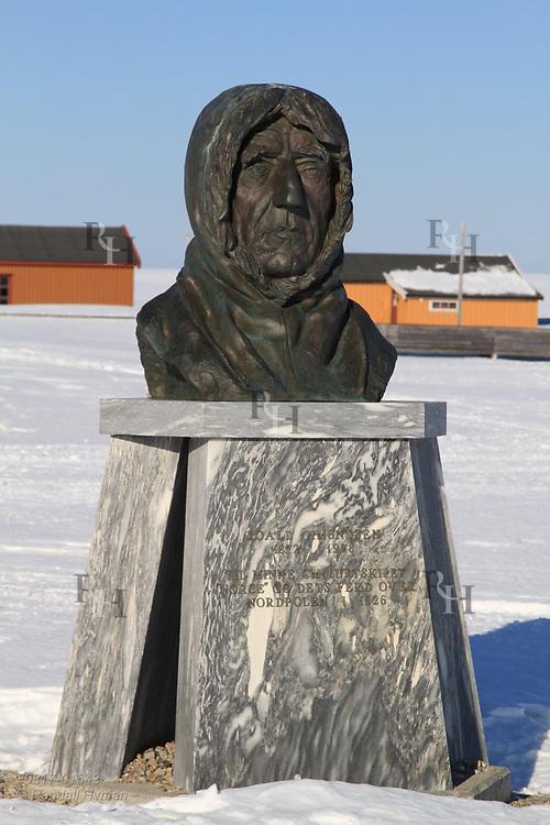 Statue of Roald Amundsen, Norwegian polar explorer, stands in center of the international science village of Ny-Alesund on Spitsbergen island in Kongsfjorden; Svalbard, Norway.