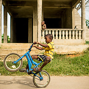 July 21, 2017, Boston, MA:<br /> A local boy pops a wheelie on his bicycle in El Mamón during the 2017 Lindos Sueños trip in the Dominican Republic Friday, July 21, 2017. <br /> (Photo by Billie Weiss/Boston Red Sox)