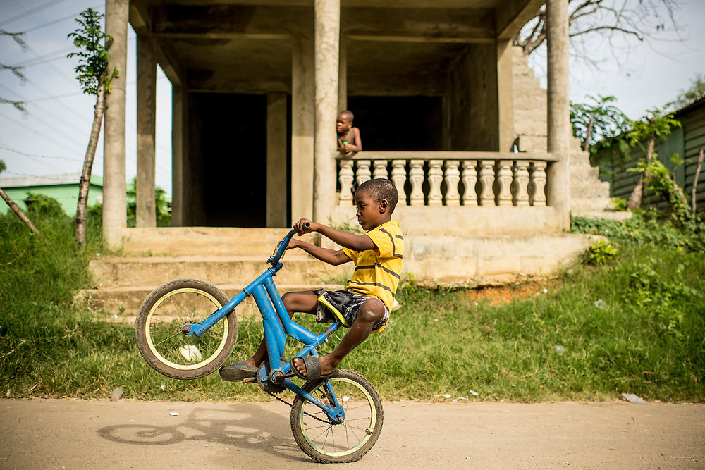 July 21, 2017, Boston, MA:<br /> A local boy pops a wheelie on his bicycle in El Mam&oacute;n during the 2017 Lindos Sue&ntilde;os trip in the Dominican Republic Friday, July 21, 2017. <br /> (Photo by Billie Weiss/Boston Red Sox)