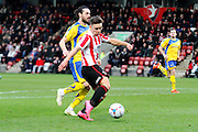 Billy Waters has a shot during the Vanarama National League match between Cheltenham Town and Altrincham at Whaddon Road, Cheltenham, England on 19 December 2015. Photo by Carl Hewlett.