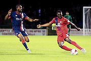 York City defender Femi Illesami closed down by Doncaster Rovers midfielder Dany NGuessan  during the Johnstone's Paint Trophy match between York City and Doncaster Rovers at Bootham Crescent, York, England on 6 October 2015. Photo by Simon Davies.