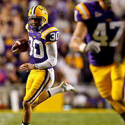 October 16, 2010; Baton Rouge, LA, USA; LSU Tigers punter Josh Jasper (30) runs a fake against the McNeese State Cowboys during a game at Tiger Stadium. LSU defeated McNeese State 32-10. Mandatory Credit: Derick E. Hingle