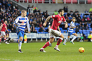 Reading forward Matej Vydra chases down Bristol City midfielder Marlon Pack during the Sky Bet Championship match between Reading and Bristol City at the Madejski Stadium, Reading, England on 2 January 2016. Photo by Jemma Phillips.