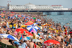 © Licensed to London News Pictures. 01/07/2016. Brighton, UK. Thousand of visitors take to the beach in Brighton and Hove as hot and sunny weather hits the seaside resort. Photo credit: Hugo Michiels/LNP