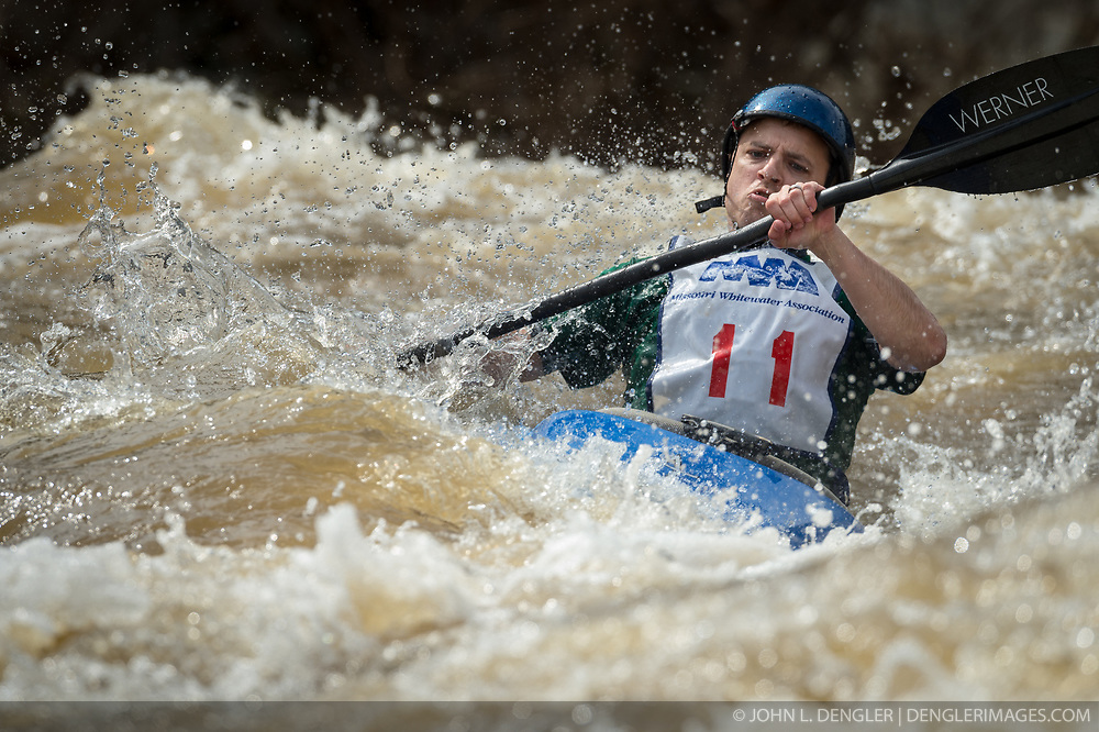 Pete Larson of Ballwin, Mo. races in the K1 Men's Expert class on the slalom course of the 45th Annual Missouri Whitewater Championships. Larson placed first in the class and fifth in the K1 Men's Long Plastic (30 and up) class. The Missouri Whitewater Championships, held on the St. Francis River at the Millstream Gardens Conservation Area, is the oldest regional whitewater slalom race in the United States. Heavy rain in the days prior to the competition sent water levels on the St. Francis River to some of the highest heights that the race has ever been run. Only expert classes were run on the flood level race course.