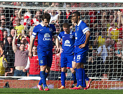 LONDON, ENGLAND - Saturday, March 8, 2014: Everton's Leighton Baines and Sylvain Distin look dejected as Arsenal score the third goal during the FA Cup Quarter-Final match at the Emirates Stadium. (Pic by David Rawcliffe/Propaganda)