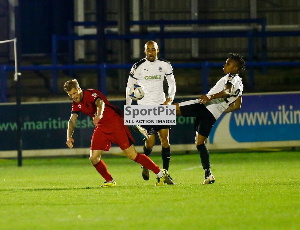 Dover's defender Aswad Thomas (21) wins a loose ball. Dover Athletic v Barrow. Vanarama National League. 10  November 2015. (c) Matt Bristow | SportPix.org.uk