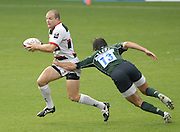 Reading, GREAT BRITAIN, Saracens Rod PENNEY, evades, Gonzalo TIESI's flying tackle.  during the EDF Energy Cup, rugby match, London Irish vs Saracens at the Madejski  Stadium, ENGLAND, 30/09/2006. [Photo, Peter Spurrier/Intersport-images].