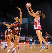 Amy Steel of the Thunderbirds with the ball and Erikana Pendersen for the Tactix in defence during the ANZ Championship Netball game between the Mainland Tactix v Adelaide Thunderbirds at Horncastle Arena in Christchurch. 20th April 2015 Photo: Joseph Johnson/www.photosport.co.nz