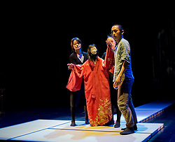 "© Copyright licensed to London News Pictures. 05/11/2010. Young Sasuke (Songha cho) receives a slap from Shun-Kin (Puppeteers Eri Fukatsu, Junko Uchida, Yasuyo Mochizuki). Complicite present ""Shun-Kin"" at the Barbican, London. Directed by Simon McBurney, based on the writings of Jun'ichiro Tanizaki."