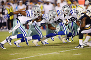 The Dallas Cowboys rush during the 2015 NFL preseason football game against the San Diego Chargers on Thursday, Aug. 13, 2015 in San Diego. The Chargers won the game 17-7. (©Paul Anthony Spinelli)