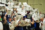Burlington fans hold up newspapers as the Rice team is introduced during the boys basketball game between the Burlington Seahorses and the Rice Green knights at Rice Memorial high School on Thursday night January 7, 2016 in South Burlington. (BRIAN JENKINS/for the FREE PRESS)
