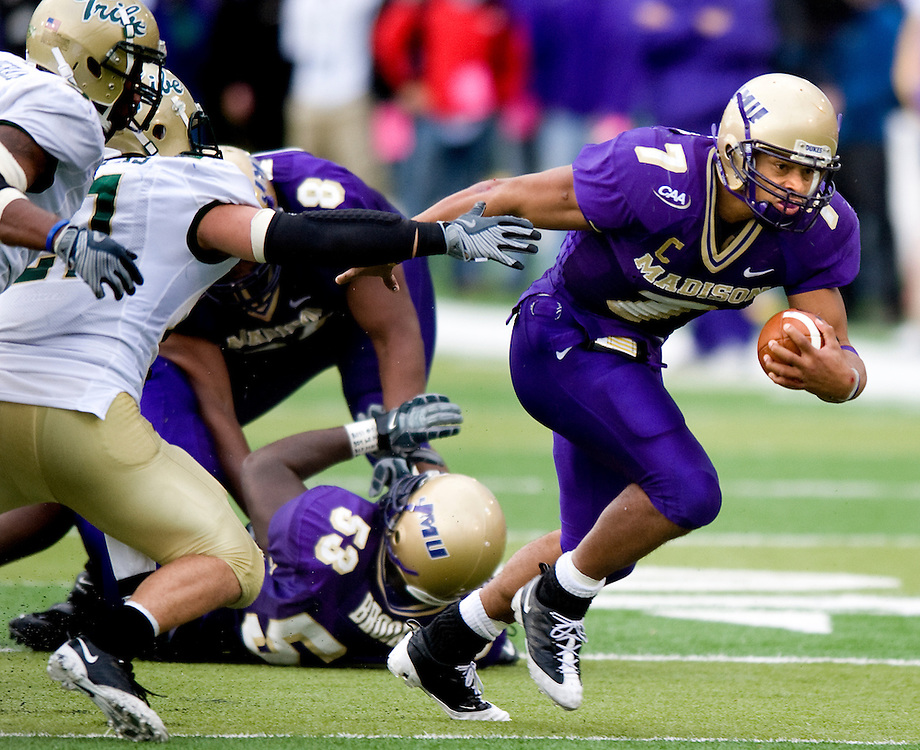 James Madison quaterback Rodney Landers breaks through the  William and Mary defense during fourth-quarter action at Bridgeforth Stadium in Harrisonburg Saturday. JMU beat the Tribe 48-24.