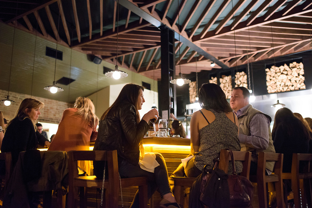 Washington, D.C. - October 10, 2014: Red Hen patrons Shana Fitzpatrick, left, Carson Paley, middle, and, John Carbonneau, right, hang out at the DC restaurant's bar Friday night October 10, 2014.<br /> <br /> <br /> Red Hen specializes in wood fired Italian food. <br /> <br /> CREDIT: Matt Roth for The New York Times<br /> Assignment ID: 30165141A