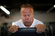 """Guests Richard Walker works out on an elliptical machine in the """"mountain"""" fitness class at the Biggest Loser Resort in Ivins, Utah September 6, 2010.  Guests at the resort affiliated with the popular reality television show are restricted to a daily 1,200 calorie diet and exercise 6 to 7 hours a day.  REUTERS/Rick Wilking (UNITED STATES)"""