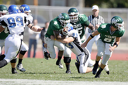 15 September 2007:  Dan Gabbard takes a shot at Marcus Dunlop. The Titans stood toe to toe with the 25th ranked Lions through the first half but ended the game on the losing end of a 25-15 score at Wilder Field on the campus of Illinois Wesleyan University in Bloomington Illinois.