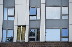 Patches where cladding has been removed from a building on the Chalcots Estate in north London, after it was confirmed by the Government to have flammable facades.