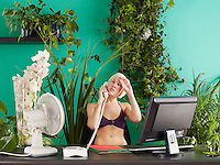 Female office worker on phone wearing bikini