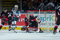 KELOWNA, CANADA - MARCH 14:  Dillon Dube #19 of the Kelowna Rockets keeps an eye on the puck as Taylor Gauthier #35 of the Prince George Cougars makes a second period save on March 14, 2018 at Prospera Place in Kelowna, British Columbia, Canada.  (Photo by Marissa Baecker/Shoot the Breeze)  *** Local Caption ***