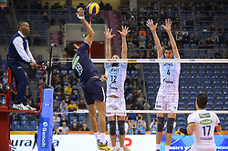 December 16, 2017 - Krakow, Poland - Filipe Ferraz (19) of Sada Cruzeiro  in action against  and Alexander Butko (12) and Artem Volvich (4) of VC Zenit Kazan  during the match between Sada Cruzeiro Volei and VC Zenit kazan during the semi finals of Volleyball Men's Club World Championship 2017 in Tauron Arena. (Credit Image: © Omar Marques/SOPA via ZUMA Wire)
