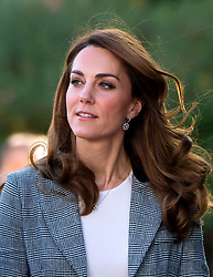 Catherine, Duchess of Cambridge, wearing a checked grey Smythe jacket and white tee-shirt, attends Shout's Crisis Volunteer Celebration Event in London on November 12, 2019.