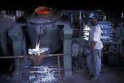 Ghananian immigrant works at Tosatti foundry in Nonantola, June 1996...1996 Nonantola (Modena), immigrato ghanese al lavoro nella fonderia Tosatti.