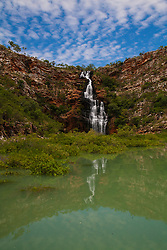Water cascades down a waterfall in Dugong Bay on the Kimberley coast.