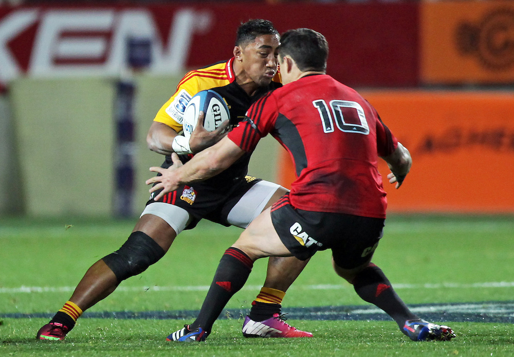 Chiefs' Bundee Aki is challenged by Crusaders' Dan Carter in a Super Rugby semi final match, Waikato Stadium, Hamilton, New Zealand, Saturday, July 27, 2013.  Credit:SNPA / David Rowland