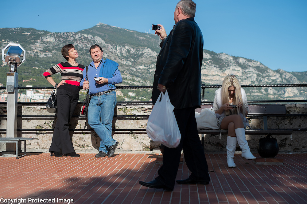 Tourist get a snap shot of themselves overlooking Fontvieille Harbor in Monte Carlo, Monaco.