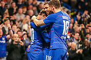 Chelsea midfielder Callum Hudson-Odoi (20) celebrates with teammates Chelsea midfielder Ruben Loftus-Cheek (12) and Chelsea forward Olivier Giroud (18) after scoring a goal( 3-0) during the Champions League group stage match between Chelsea and PAOK Salonica at Stamford Bridge, London, England on 29 November 2018.