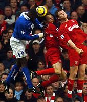 Fotball<br /> Premier League 2004/2005<br /> Foto: BPI/Digitalsport<br /> NORWAY ONLY<br /> <br /> 06/11/2004 Liverpool v Birmingham City<br /> <br /> Former Liverpool player Emile Heskey heads under pressure from Dietmar Hamann and John Arne Riise