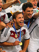 Scorer of the winning goal Mario Gotze of Germany celebrates winning the World Cup Final