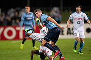 SYDNEY, AUSTRALIA - MAY 21: Kawasaki Frontale player Maguinho (26) goes over the top of Sydney FC player Mitchell Austin (21) at AFC Champions League Soccer between Sydney FC and Kawasaki Frontale on May 21, 2019 at Netstrata Jubilee Stadium, NSW. (Photo by Speed Media/Icon Sportswire)