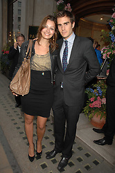 OSCAR HUMPHRIES and SARA PHILIPPIDIS at a reception to celebrate the launch of Prince Dimitri of Yugoslavia's one-of-a-kind jeweleery collection held at Partridge Fine Art, 144-146 New Bond Street, London on 11th June 2008.<br />