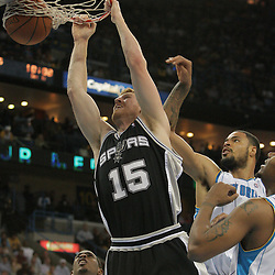17 December 2008: San Antonio Spurs center Matt Bonner (15) dunks over Hornets defenders Tyson Chandler (6) and David West (30) during a 90-83 victory by the New Orleans Hornets over the San Antonio Spurs at the New Orleans Arena in New Orleans, LA..